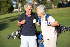 001_Senior Couple Enjoying Game Of Golf photo