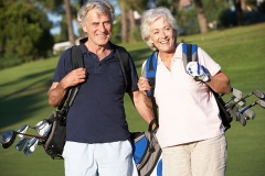 Senior Couple Enjoying Game Of Golf